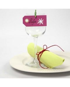 A Manilla Tag with a punched-put Design as a Place Card