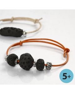 A Bracelet made from Clay Beads, blackened on a Bonfire