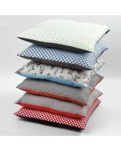 A Cushion Cover made from organic Vivi Gade Fabric