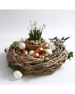 A natural Wreath decorated with Birds, Feathers and Eggs