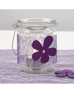 A Candle Holder with a purple Net Waist Band and a wooden Flower
