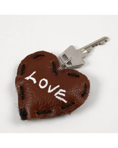 A Leather Heart with Text as a Key Fob