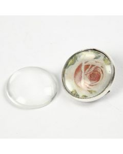 A transparent Cabochon on a cut-out Design in a Brooch