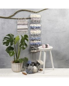 A long Wall Hanging, woven from mixed Materials