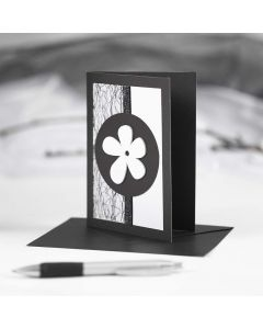 A black Greeting Card with black and white Decorations