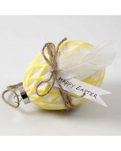 A Ceramic Egg painted and decorated with natural Twine and Feathers