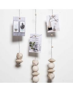 A Mobile made from Florist Wire with Magnets for hanging Photos etc.
