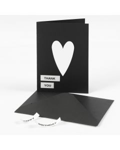A Greeting Card with Text on DYMO Tape and a Card Heart