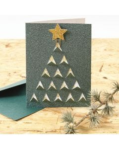 A Christmas Card with a graphic cut-out Christmas Design on the Front