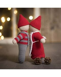 A kissing elf couple crocheted from maxi cotton yarn