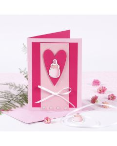 An Invitation with a Baby Bottle for a Christening
