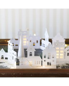 A Silhouette Card Town decorated with Glitter Paper and Vellum Paper