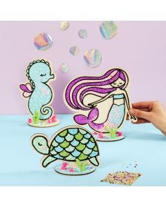 A wooden Turtle, Mermaid, and Sea Horse filled with Foam Clay
