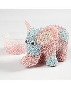 A Papier-mâché Elephant covered with Pearl Clay and Googly Eyes