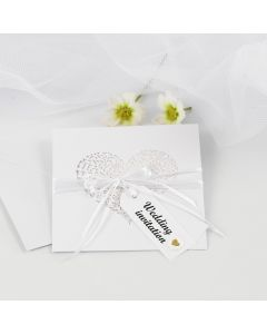 A Wedding Invitation with Satin Ribbon and Manilla Tags decorated with Puffy Stickers