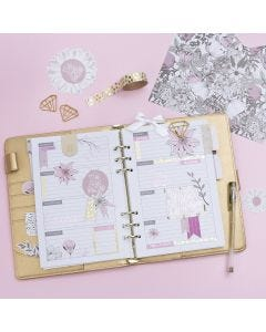 A decorated 5-week Planner for a Bullet Journal and a Calendar