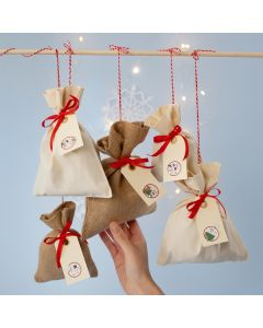 An Advent Calendar from Fabric Bags with a Numbered Sticker on Manilla Tags