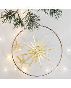A Straw Star hung in a Metal Hoop