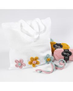 A Shopping Bag decorated with Knitted Tube Flowers