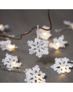 Snowflakes crocheted from cotton yarn