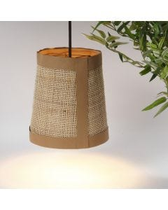 A lamp shade from faux leather paper and rattan
