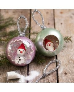 Christmas baubles decorated with Art Metal paint, glitter and Silk Clay mini figures
