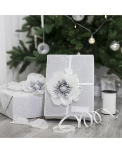 Gift wrapping decorated with a tissue paper flower