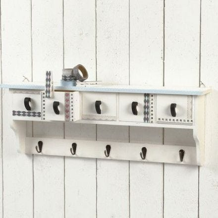 A Wooden Coat Rack with Masking Tape