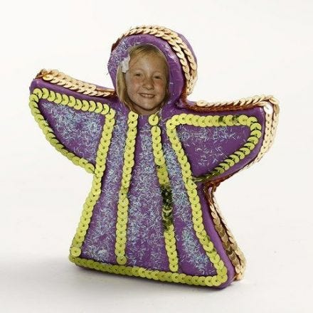 A standing painted Angel decorated with Sequin Ribbon