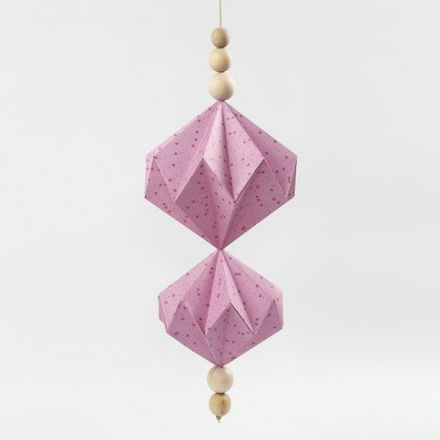A hanging Decoration with Vivi Gade Design Paper Diamonds