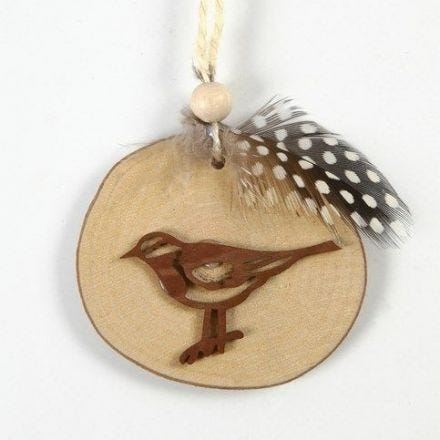 A Bird on a wooden Disc with decorated Flax Twine for hanging
