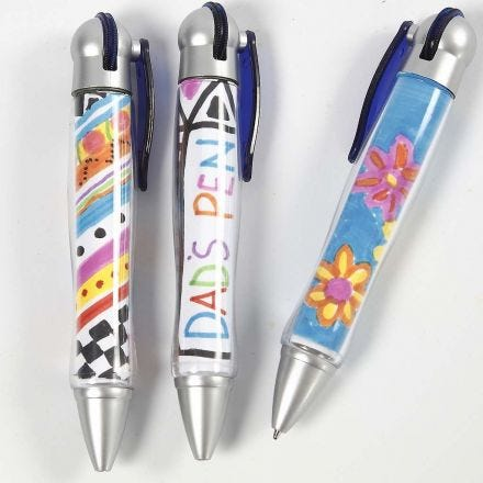 Pens with Drawings under a transparent Cover