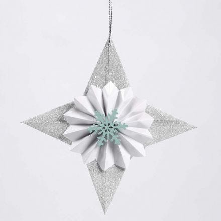 A Glitter Paper Star decorated with a Rosette and a Snowflake