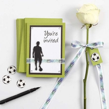 A green and white Invitation and Table Decorations for a Confirmation Party