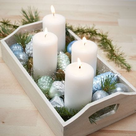 A Tray with four Candles and painted Glass and Terracotta Christmas Baubles