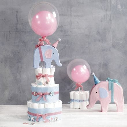 A tiered Nappy Cake with Elephants  and Balloons