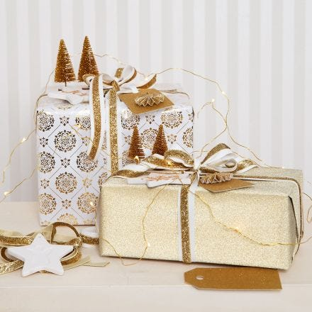 Gold Christmas Gift Wrapping decorated with Glitter Decorations