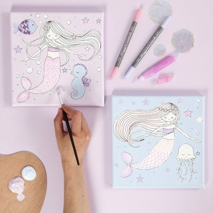 A Canvas with a Mermaid Design decorated with Markers and Glitter Glue