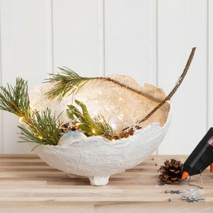 A Gauze Bandage Bowl with Glitter, decorated  with Glass Baubles, Cones etc.