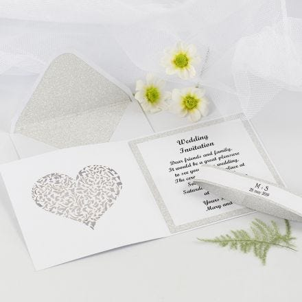 A Wedding Invitation and Envelope decorated with Design Paper