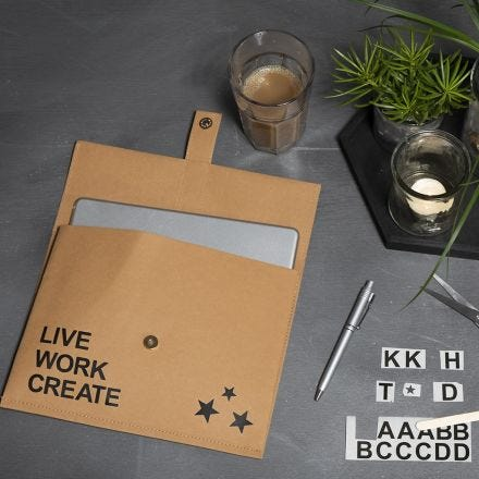 A Faux Leather Paper Bag decorated with Rub-on Stickers