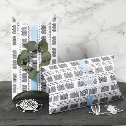 Pillow Boxes decorated with blue Ribbon, a Metal Ring and Maritime Card Cut-out Decorations