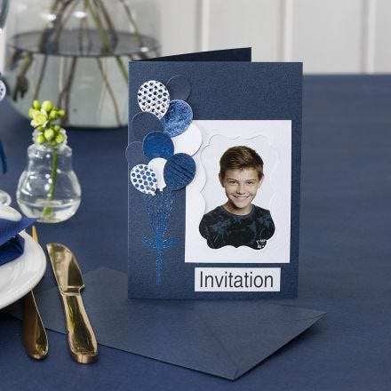 An Invitation with a Photo and punched-out Balloons decorated with Deco Foil