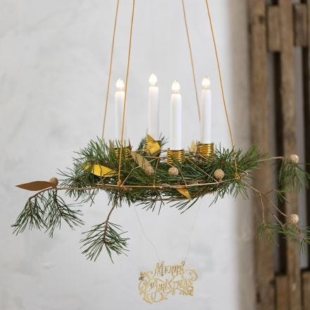 A hanging Advent Wreath with Candle Holders from Bonsai Wire and Faux Leather Paper Decorations