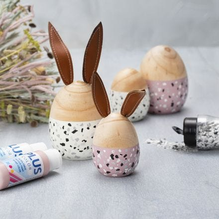 Wooden Eggs and Rabbits painted with Plus Color and decorated with Terrazzo Flakes