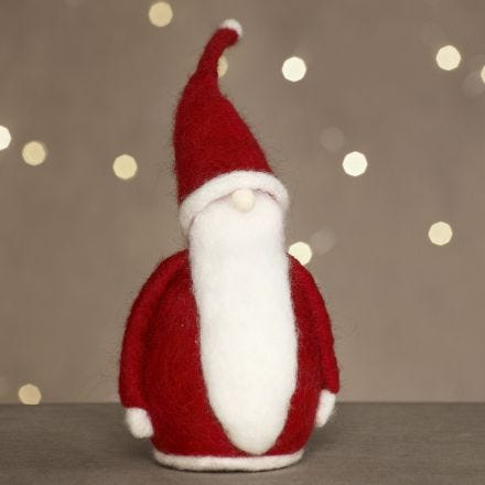 A Father Christmas needle felted on polystyrene