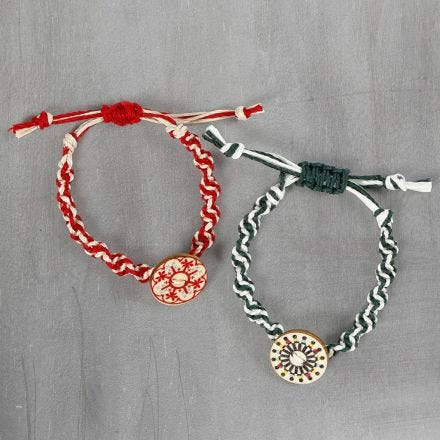 A braided bracelet made from bamboo cord with a wooden button