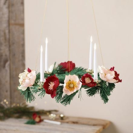 An Advent wreath with crepe paper flowers
