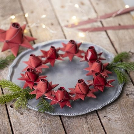 A woven Christmas star with a rose bud