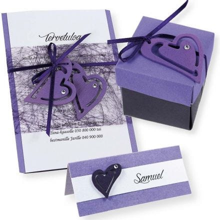 A purple and white Invitation, Place Card and Table Decorations